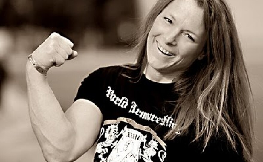 Carolyn Fisher has won five world arm wrestling championships. She entered her first tournament to win a pair of cowboy boots.