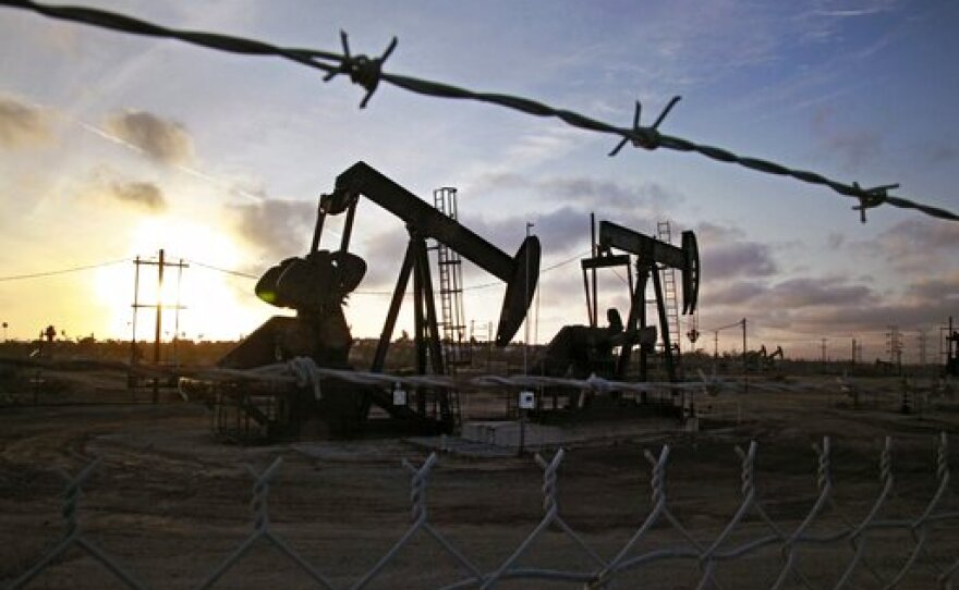 In this Thursday March 6, 2014, file photo, the sun sets beyond pumpjacks operating at the Inglewood oil fields in the Baldwin Hills area of Los Angeles.