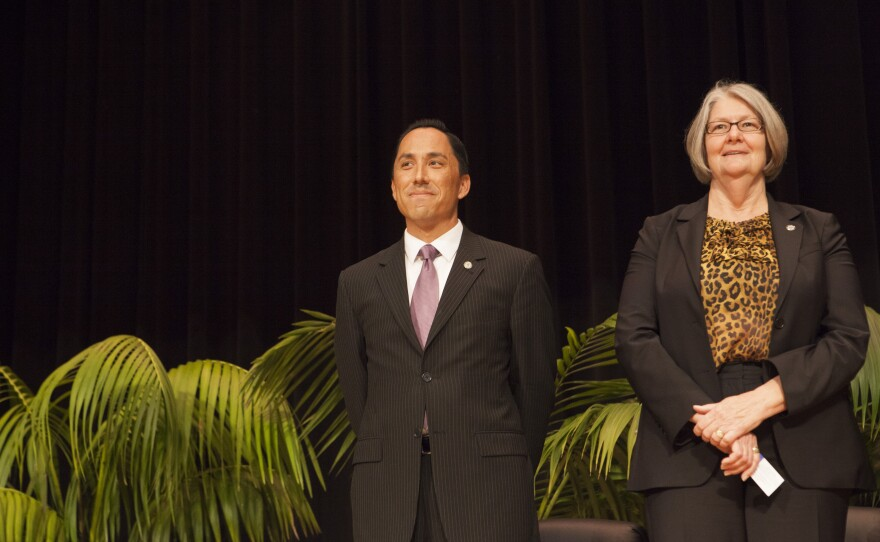 San Diego City Council members Todd Gloria and Sherri Lightner share a stage during the council inauguration ceremony, Dec. 10, 2014.
