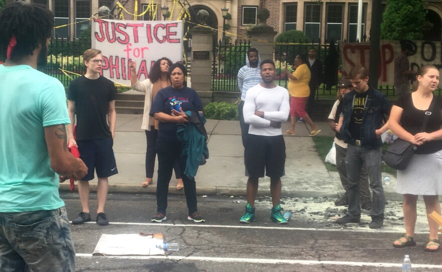 About 200 people gathered outside the Minnesota Governor's Residence in St. Paul on Thursday, protesting the fatal shooting of a man by a police officer. Philando Castile was shot in a car Wednesday night in the St. Paul suburb of Falcon Heights.
