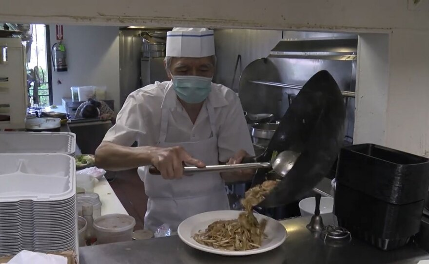 The chef of Hunan Chinese Restaurant working in the restaruant's kitchen in Rancho Bernardo. Sept. 2, 2020.