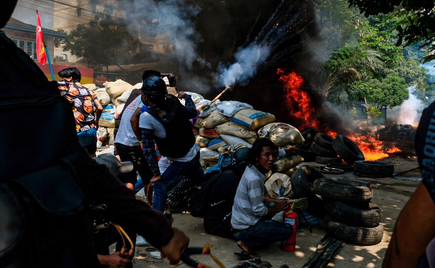 Smoke rises from burning tires on Saturday as demonstrators gather in Thakeyta Township, Yangon, to continue their protest against the military coup in Myanmar.