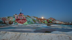 Salvation Mountain, with the moon rising.