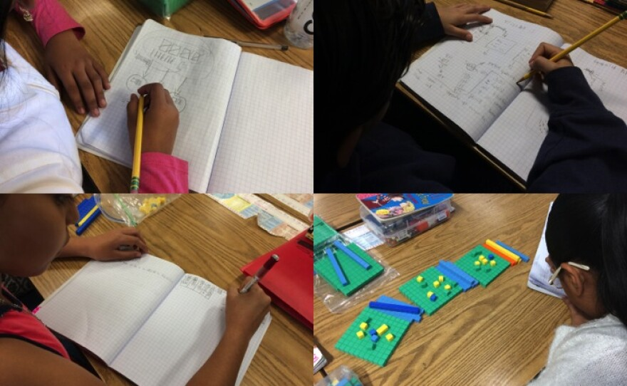 Perkins Elementary School students in Mymy Chau's fourth-grade class solve a division problem four different ways, March 2, 2017.
