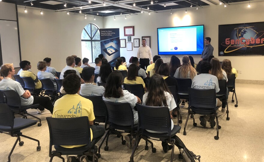 City of San Diego's Chief Information Security Officer Darren Bennett speaks with students inside a classroom at University of San Diego about cyber security, June 25, 2018.