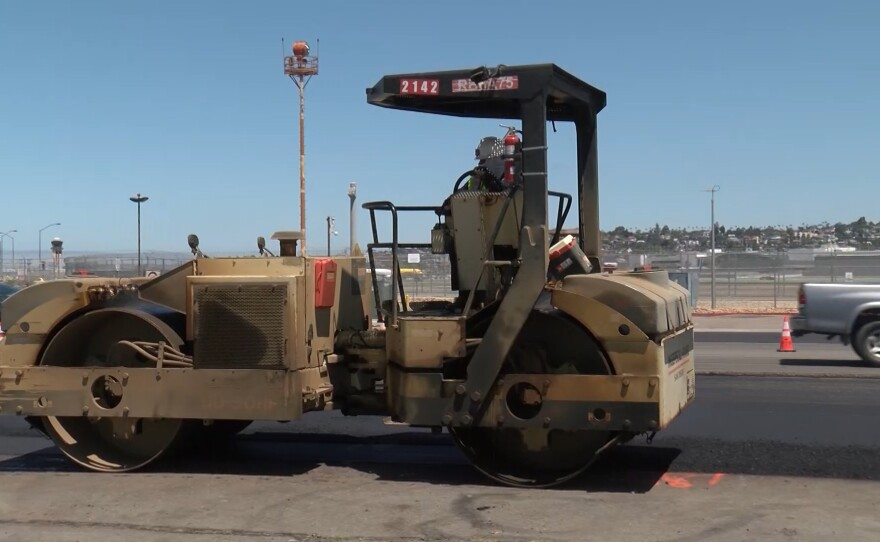 A construction worker repaving North Harbor Drive in downtown San Diego on May 12, 2020.