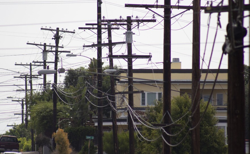 A trail of electric grid wires and poles travels across the skyline in South Park, July 27, 2020.