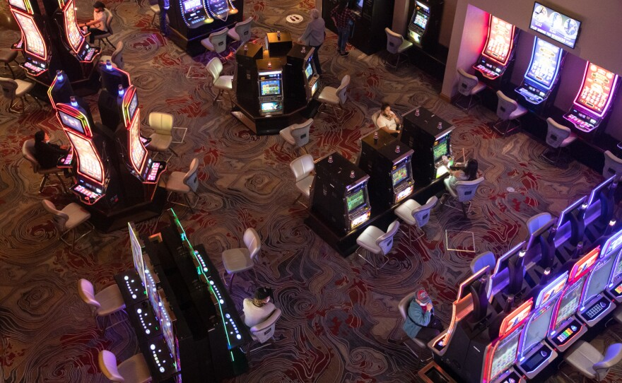 Visitors are seen on the floor of the Sycuan casino in East County, Aug. 14, 2020.