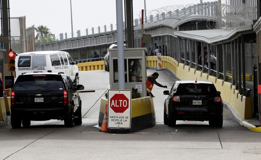 Vehicles cross over to Mexico at the Gateway International Bridge, Friday, March 20, 2020, in Brownsville, Texas.