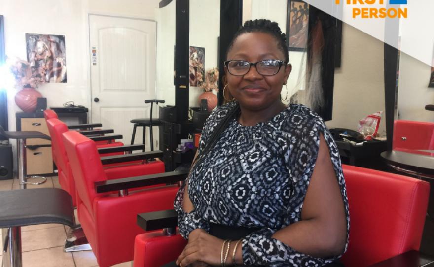 Queentabel Banka sits in her hair braiding salon in San Diego's City Heights neighborhood, Feb. 15, 2018.