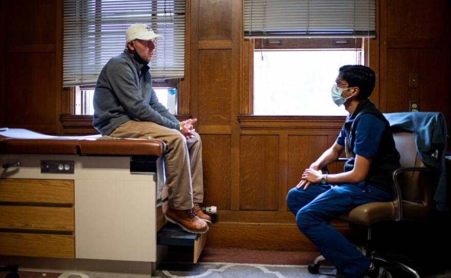 Dr. Monish Ullal speaks with a patient at the Bridge substance use clinic at Highland Hospital in Oakland on Oct. 6, 2021.