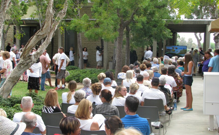 An overflow crowd fills the courtyard outside Carlsbad City Hall, as the City Council votes on a plan to build a shopping center on the shores of the Agua Hedionda Lagoon, Aug. 25, 2015.