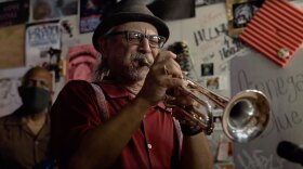 Trumpet player Bill Caballero is pictured in a still from a performance video.