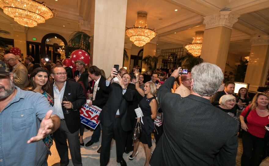 San Diegans at a Republican election party at the U.S. Grant Hotel celebrate after the announcement that Donald Trump won the presidency.