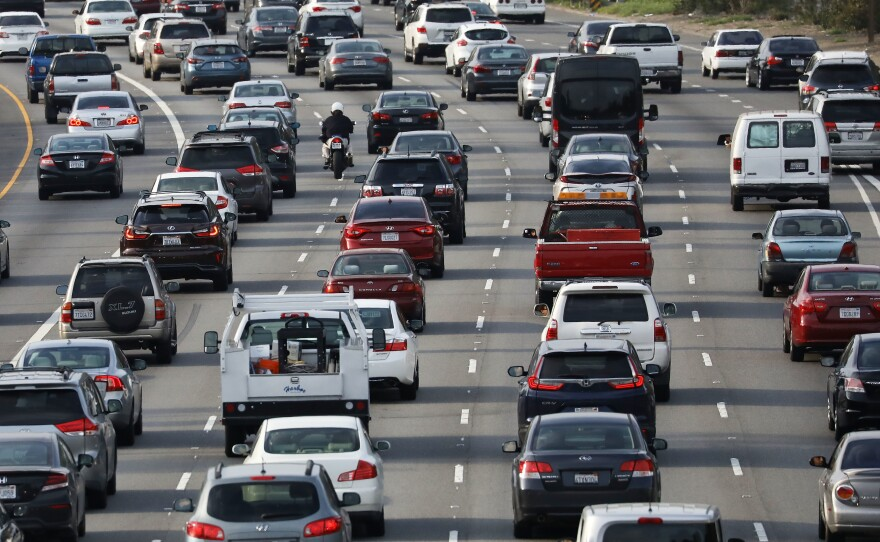 Vehicles pass during the afternoon commute on Highway 101 in Los Angeles on April 2. California is suing the EPA over a plan to revise fuel efficiency standards for vehicles, weakening Obama-era limits on greenhouse gas emissions.