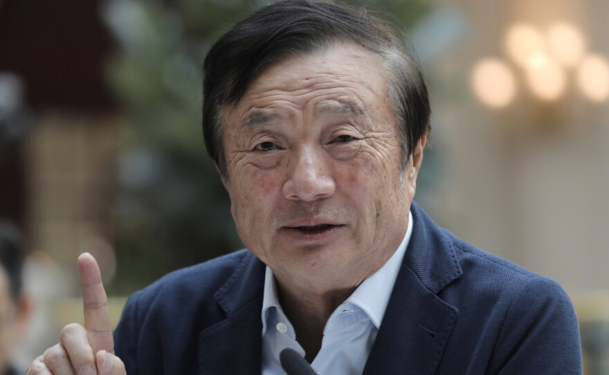 Ren Zhengfei, founder and CEO of Huawei, speaks with media Tuesday in Shenzhen, China.