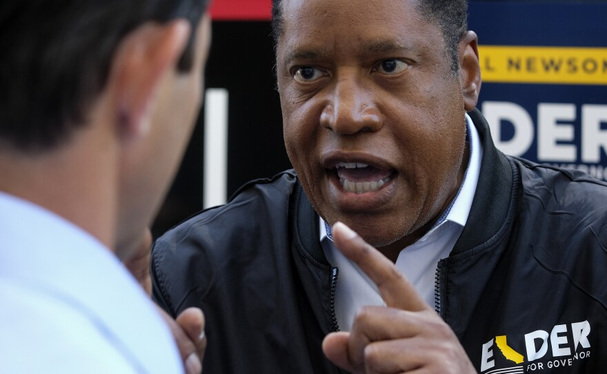 Republican conservative radio show host Larry Elder argues with a TV reporter during an interview after visiting Philippe The Original Deli during a campaign for the California gubernatorial recall election on Monday, Sept. 13, 2021, in Los Angeles.