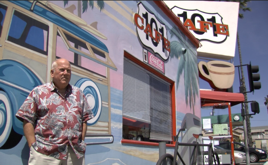 John Daley is the original owner of the 101 Cafe on Coast Highway in Oceanside. The murals painted on the wall of the cafe have changed several times over the years, but visitors still take photographs next to the woodie station wagons, March 28, 2017.