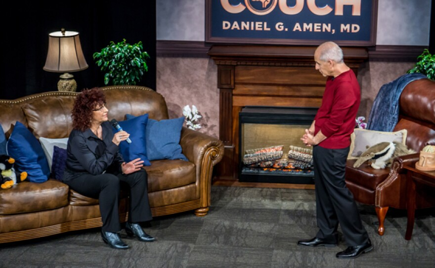 """A guest interacts with Dr. Daniel Amen on the set of """"On The Psychiatrist's Couch."""" In his 10th national public television special Dr. Amen gives viewers the most important lessons he has taught thousands of patients over the last 35 years."""