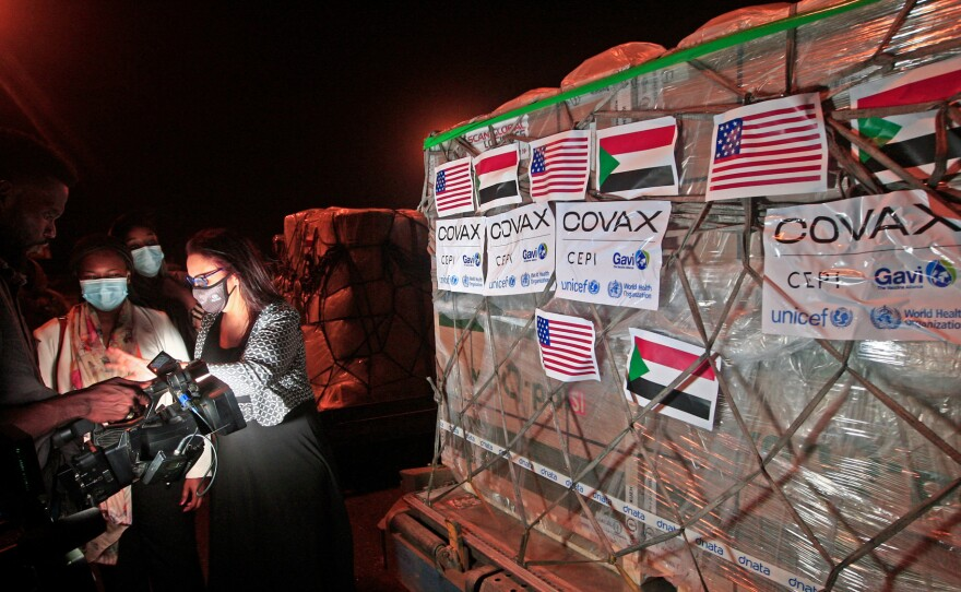 COVID-19 vaccines from COVAX, the international vaccine-sharing program, arrive in Khartoum, Sudan, on Aug. 5. In a letter to President Biden, health experts are asking him to take action to manufacture and distribute vaccines to the entire world.