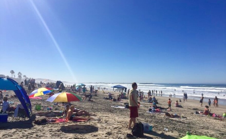 Hundreds of people are at Mission Beach this hot Presidents Day holiday, Feb. 15, 2015.