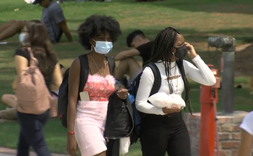Students walking through San Diego State campus on the first day of class, Aug. 23, 2021.