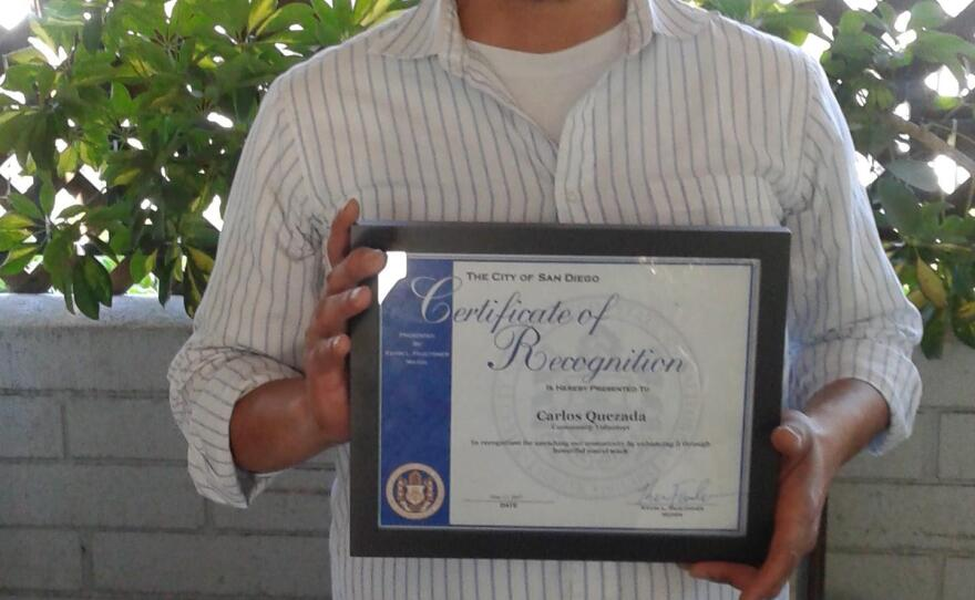 Carlos Quezada poses with his certificate from San Diego Mayor Kevin Faulconer, June 9, 2017.