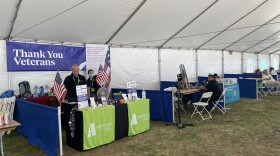 A booth with a sign that reads 'Thank You Veterans' is under a tent at the North County Veterans Stand Down  event in Vista. September 16, 2021.