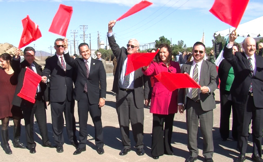U.S. and Mexico officials wave flags to signal the beginning of construction on a $700 million border infrastructure project in Otay Mesa, Dec. 10, 2013. Dignitaries include: Assemblywoman Lorena Gonzalez, D-San Diego, county Supervisor Greg Cox, San Diego Association of Governments Chairman Jack Dale, Consul General of Mexico in San Diego Remedios Gomez-Arnau, and state of Baja Director of International Relations Mariano Escobedo.
