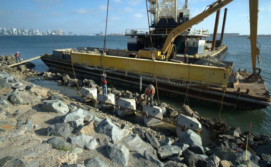 Crews install artificial tidepools on the coast of Harbor Island on Feb. 25, 2021