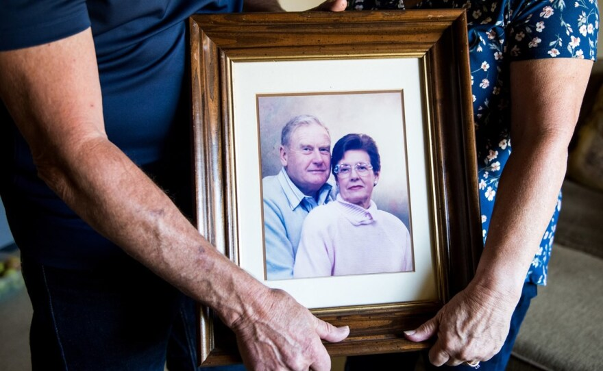 Mark and Kathy Allen hold a photo of Mark's parents at their home in Sebastopol on July 29, 2020. Mark and Kathy evacuated Mark's mother and several other residents of the Villa Capri retirement community as the Tubbs Fire approached in October 2017.