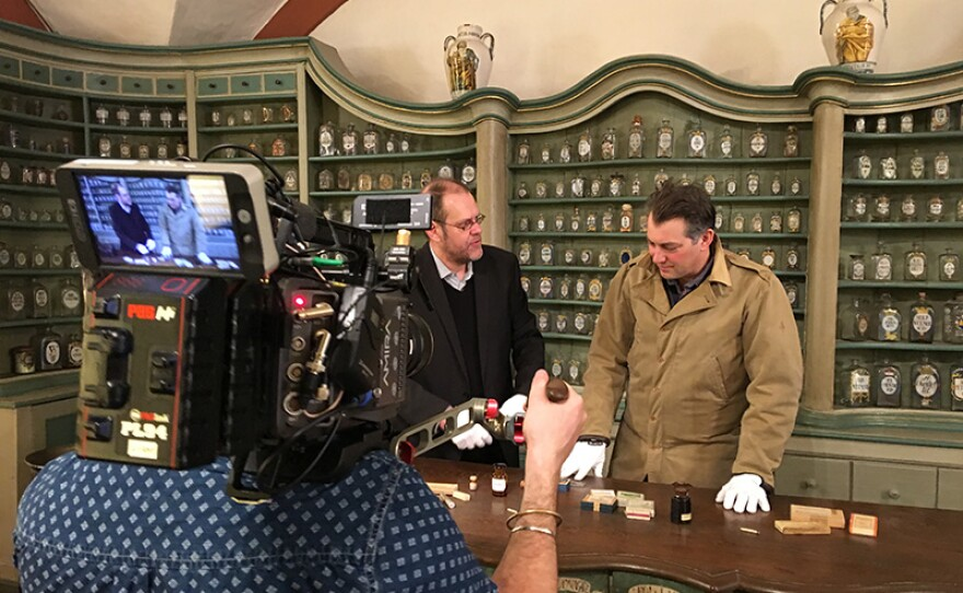 Inside the German Pharmacy Museum, James Holland (right) meets with medical historian, Dr. Peter Steinkamp of Ulm University. Cory films interaction.