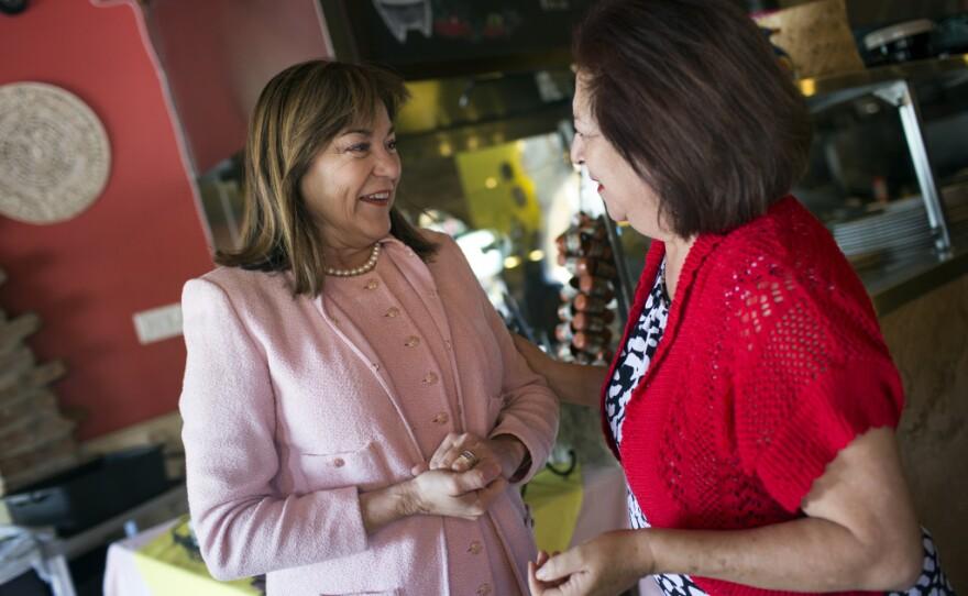 Democratic Rep. Loretta Sanchez, who is running for the U.S. Senate, greets Rosalind Davis, owner of Tlaquepaque Restaurant in Placentia, Feb. 23, 2016.