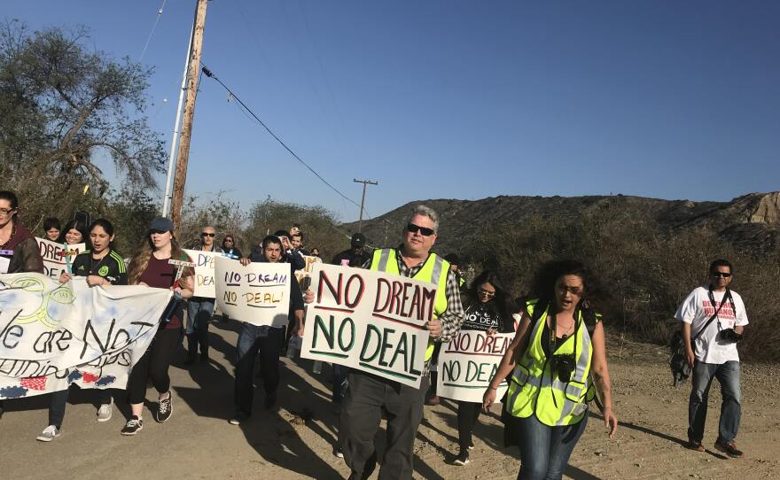 A group of immigrants living in the U.S. illegally, DACA recipients and allies march through Border Field State Park, Feb. 7, 2018.