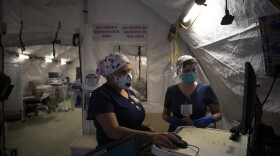 Nurses Karla Salazar, right, and Marisol Perez work in a tent set up to help treat COVID-19 patients at El Centro Regional Medical Center in El Centro on July 21, 2020.