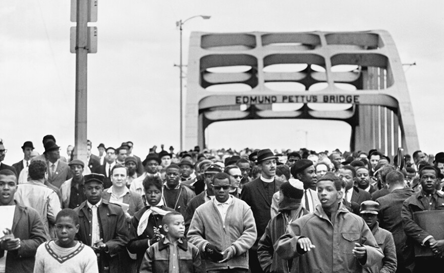 John Lewis led marchers across the Edmund Pettus Bridge in Selma, Ala. on March 7, 1965.