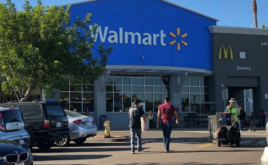 Shoppers walk into a San Diego Walmart store on Monday, Dec. 14, 2020.