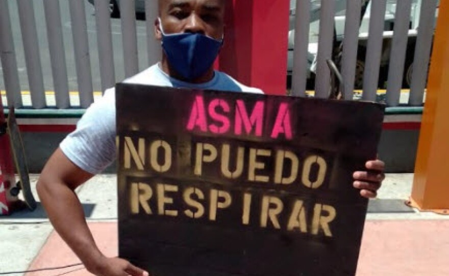 Jean Denis Louis holds up the sign he held for the Black Lives Matters protest in Tijuana on June 14, 2020.