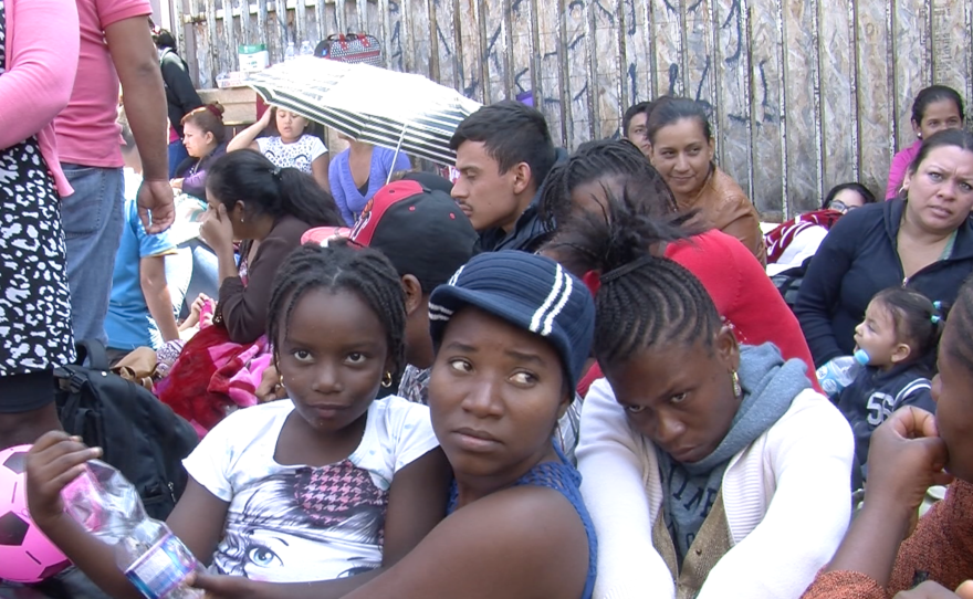 Migrants from Haiti and Africa wait outside the San Ysidro Port of Entry, June 2, 2016.