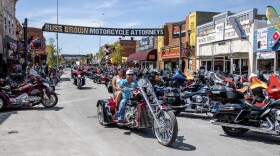 Bikers ride down Main Street during the 80th annual Sturgis Motorcycle Rally in Sturgis, South Dakota. Saturday, Aug. 15, 2020.