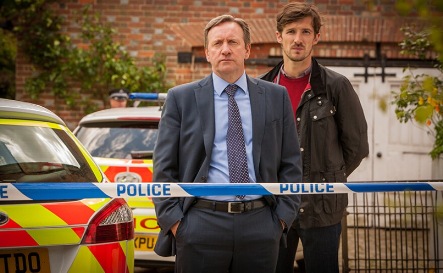 """Detective Chief Inspector John Barnaby (Neil Dudgeon) and Detective Sergeant Charlie Nelson (Gwilym Lee) in a scene from MIDSOMER MURDERS """"The Dagger Club."""""""