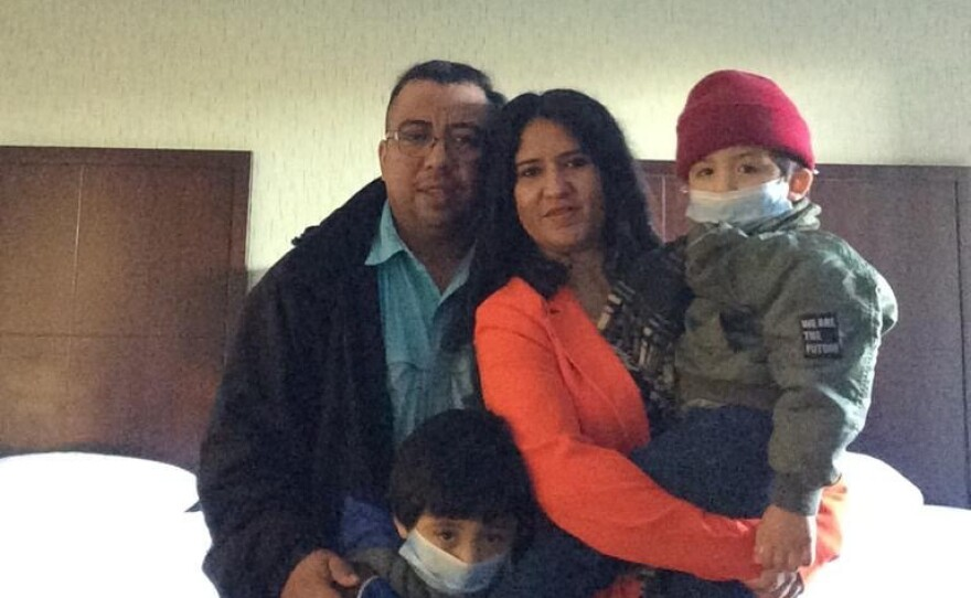 Gerson Eduardo Cano and his family pose for a photo in a San Diego hotel, shortly after being processed for asylum at the San Ysidro Port of Entry, Feb. 26, 2021.