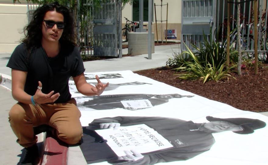 Photographer Rafael Rios discusses a mural he helped create, June 13, 2016.