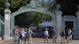 Students walk past Sather Gate on the University of California, Berkeley campus in Berkeley, Calif., April 21, 2017.