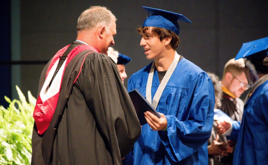 Matanzas High School Principal Jeff Reaves shakes a student's hand on graduation day. Reaves handwrote 459 notes to the graduating class of 2021 to celebrate their accomplishments.