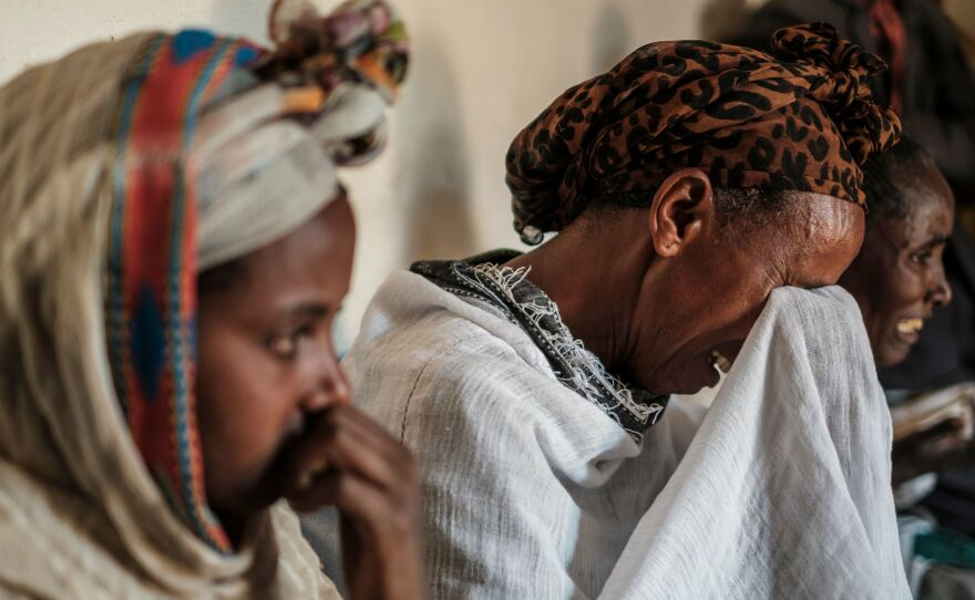 People mourn the victims of a massacre allegedly perpetrated by Eritrean Soldiers, at the house of Beyenesh Tekleyohannes, in the village of Dengolat, North of Mekele, the capital of Tigray. The U.S. announced visa and aid restrictions to Ethiopia due to the months long conflict in the  Tigray region.