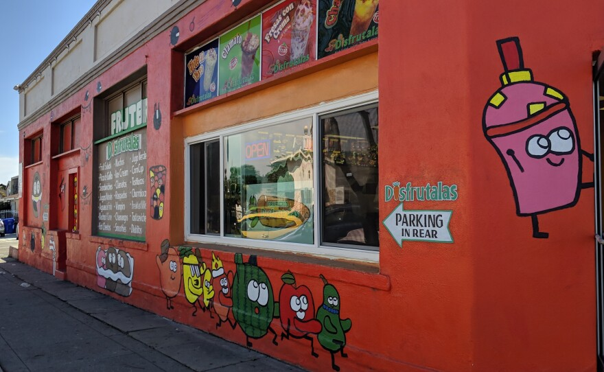The storefront of the restaurant Disfrutalas in San Diego's City Heights neighborhood features cartoon fruit painted by a 14-year-old artist, March 28, 2019.
