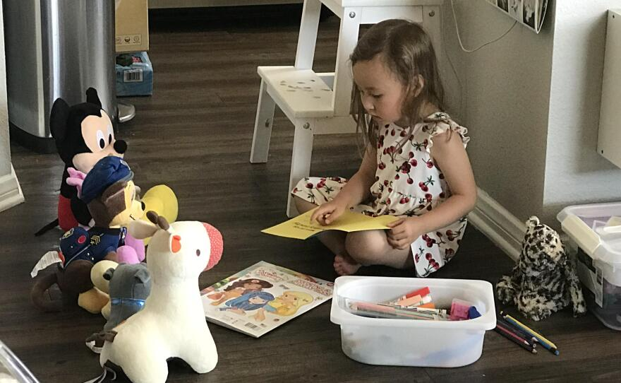 Aaron Jacobson's daughter Amelia plays alone at home in this undated photo.