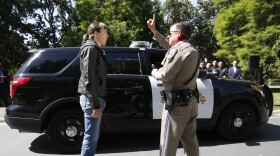 California Highway Patrol Officer Gary Martens, right, has CHP Sgt. Jaimi Kenyon, follow his finger during a demonstration of how drivers, suspected of impaired driving, are currently tested, Wednesday, May 10, 2017, in Sacramento, Calif.