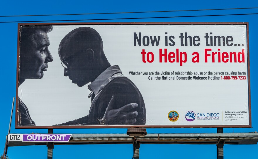 """A domestic violence campaign billboard reads """"Now is the time ... to help a friend,"""" Oct. 4, 2018."""